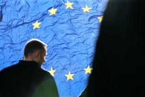 figure-with-european-flag-in-the-background